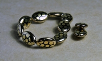 50201142  5 X Glaskraal Goud 20x14mm.